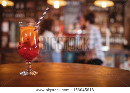 Close-up of cocktail drink served on table in pub