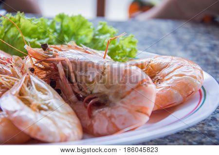 Shrimp boil seafood in the dish selective focus of eye shrimp