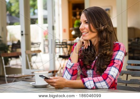 Beautiful woman in cafe holding phone