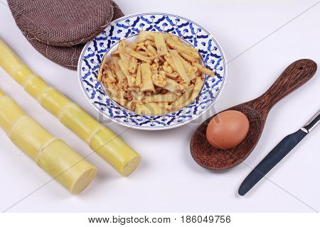 Fried Soft Bamboo Pole Shoots With Egg And Kitchen Equipment Cooking.