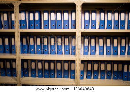 Blue files arranged on metallic cabinet