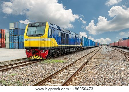 Cargo train platform with freight train container at depot in port use for export logistics background.