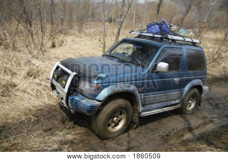 Jeep Got Stuck In Mud With Motion Blur Wheels At Spring Forest