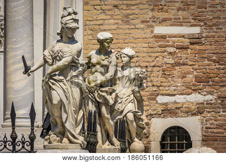 Classical sculptures at the Porta Magna main gate of the Venetian Arsenal in Venice, Italy.