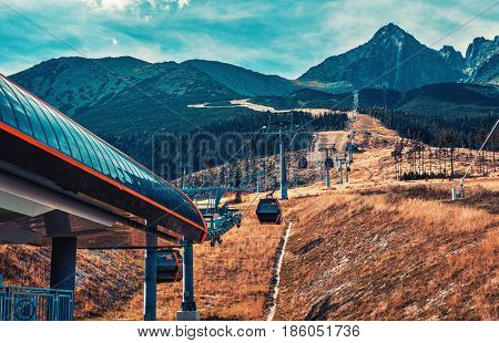 Cableway in High Tatra Mountains. Autumn dramatic colors.
