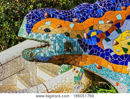 Barcelona, Spain - May 6, 2017: Lizard fontaine in Barcelona, Spain. Mosaic sculpture in Park Guell