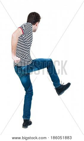 back view of skinny guy funny fights waving his arms and legs. Isolated over white background. Rear view people collection.  Funny guy clumsily boxing. The guy in the striped shirt jumping.