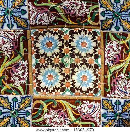 Broken glass mosaic tile decoration in Park Guell, Barcelona, Spain. Designed by Gaudi