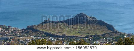 Scenic panoramic high angle view from Perchem mountain towards Sudak Genoese fortress Crimea Russia.