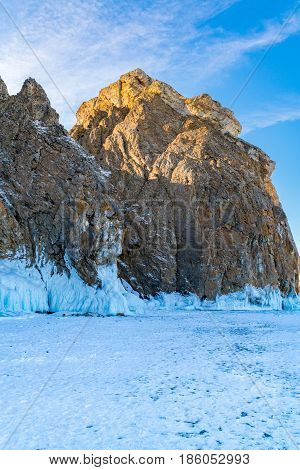 Famous Deva Rock with snow and icicles at northern Cape Khoboy in Frozen Lake Baikal Russia