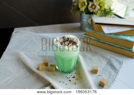 Green mint coffee with with cream and colorful decoration. Milk shake cocktaill frappuccino. Unicorn coffee unicorn food.