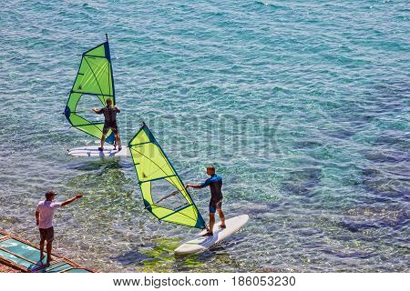 Croatia, Brac island - Mat 11, 2017: Windsurfing on Adriatic sea, Croatia, Brac island