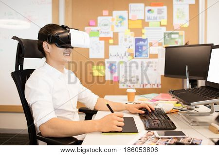 Designer using digitizer and VR glasses while working in office