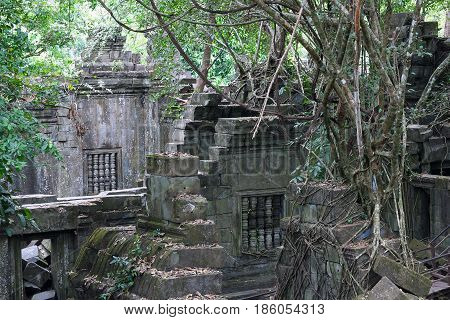 Ruins of ancient Beng Mealea Temple over jungle in Cambodia. Beng Mealea (early 12th century) is a temple located 40 km east of the main group of temples at Angkor its name means