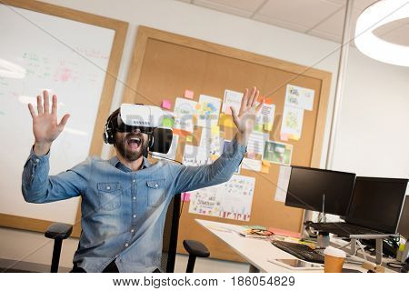 Businessman screaming while experiencing virtual reality in modern office