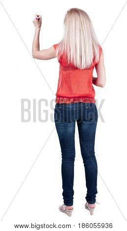 back view of writing beautiful blonde woman. Young girl in jeans draws. Rear view people collection.  backside view of person. Isolated over white background.