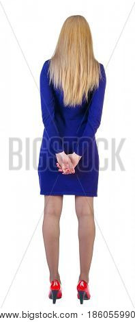 back view of standing beautiful blonde business woman. Young girl in violet dress and red kitten heels.  Rear view people collection.  backside view of person.  Isolated over white background.