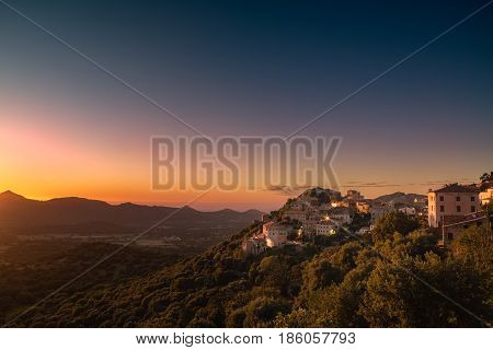 Village Of Belgodere In Corsica Lit By Dramatic Sunset