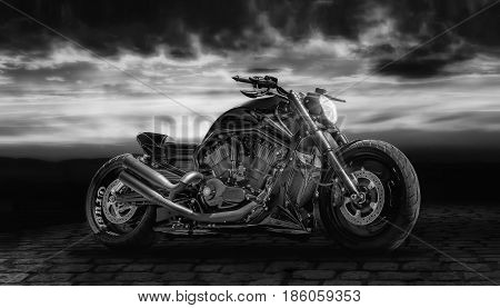 Black motorcycle with sunset in the background