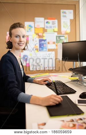 Portrait of photo editor working at desk in office