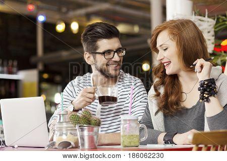 Freelance Couple Working On Laptop