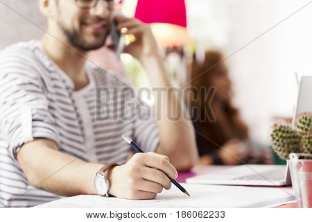 Hipster Businessman Taking Notes