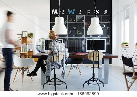Simple style office with wood desk chairs and computers