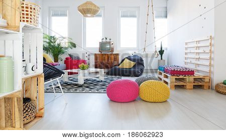Colorful retro living room with pouf tv swing crate furniture