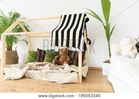 Botanical eco friendly decor in natural minimalist kids room