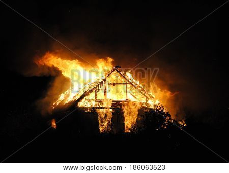 Fire village house at night. A big fire swept through the whole building