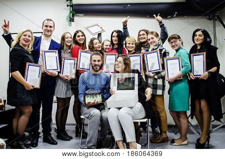 October 10 2016. Rostov-on-Don. Russia. Group of graduates of photo cources with teachers and a delicious festive cake