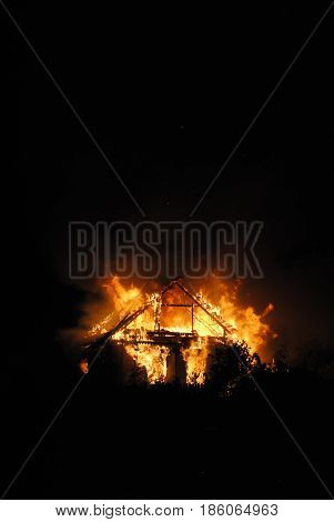 A Wooden house in flames insurance risk without people