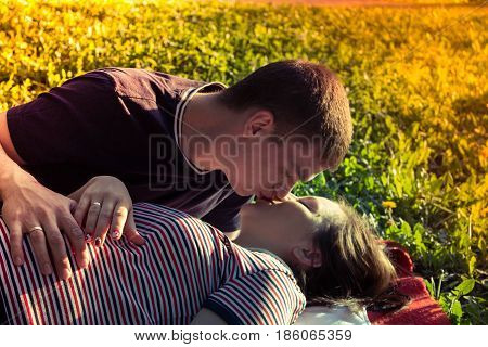 Happy couple standing together in Park. kissing