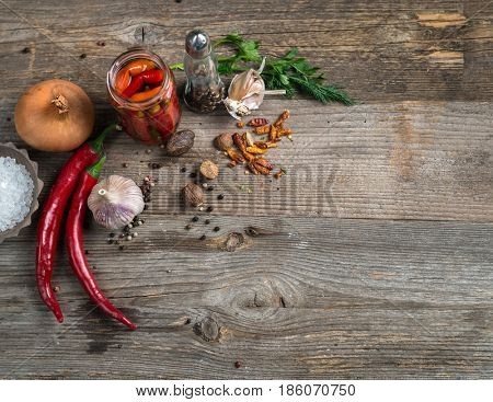 Spices and onion ready for cooking, additional textspace left on the side, topview