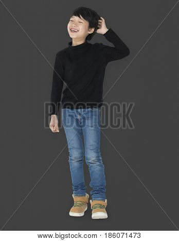 Asian kid laughing scratching his head portrait