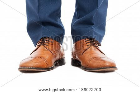 Feet Of Man With Brown Shoes In Close-up