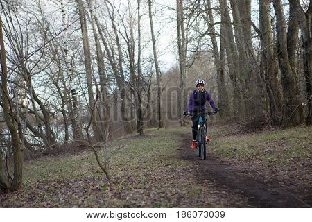 Woman in helmet riding bicycle