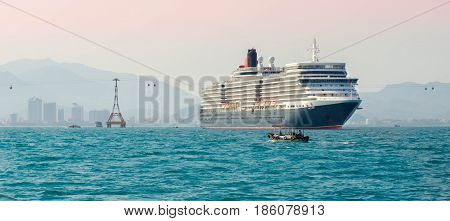 A large cruise ship enters the port