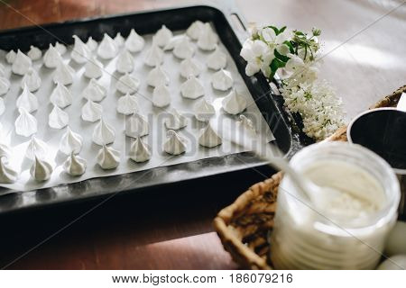 home made meringues on Baking tray close up