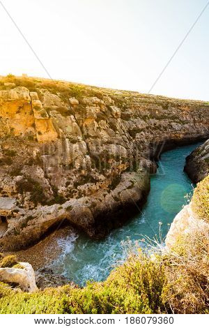 The narrow inlet and beach at Wied il-Ghasri Gozo. Malta