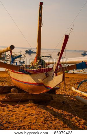 Balinese Boats In Sanur Beach In The Morning At Dawn, Bali, Indonesia.