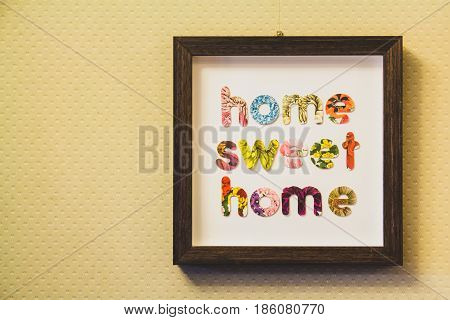 Framed letters home sweet home hung on a wall