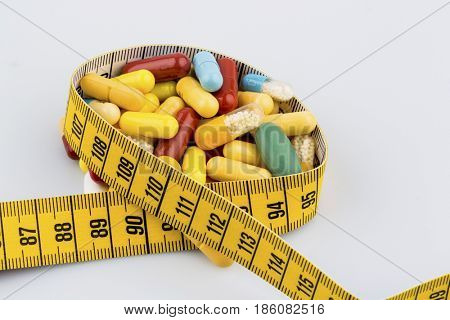 tablets and measuring tape