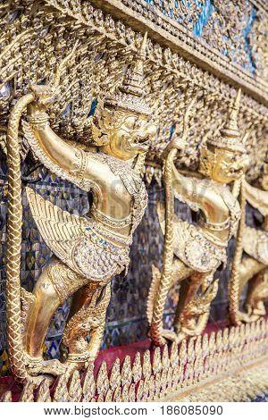 Golden garuda figures at Wat Phra Kaew (Temple of the Emerald Buddha) in Bangkok