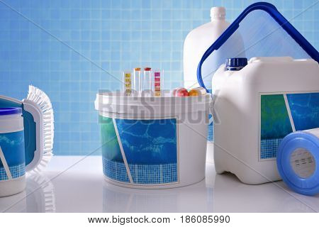 Chemical Cleaning Products For Pool With Blue Mosaic Background