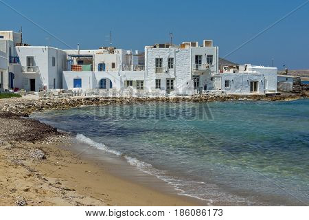 Old white house and Bay in Naoussa town, Paros island, Cyclades, Greece