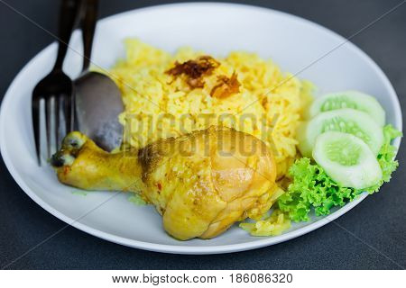 Muslim yellow jasmine rice with chicken (Khao mok kai) Halal chicken and curry rice.