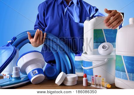 Swimming Pool Maintenance Worker With Blue Background