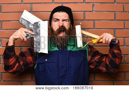 Bearded Foreman Holding Various Building Tools With Satisfied Face