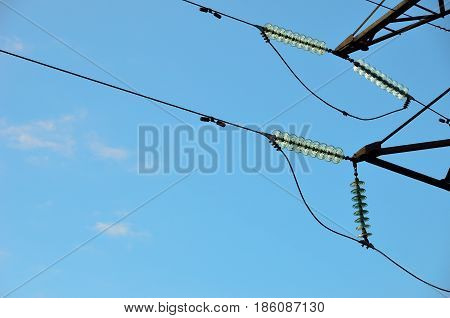 High voltage. Transmission line Insulators. Blue sky background.